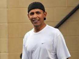 Obama wearing hat backwards