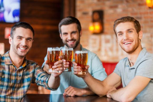enjoying-beer-friends-three-happy-young-men-casual-wear-toasting-sitting-bar-together-48777898